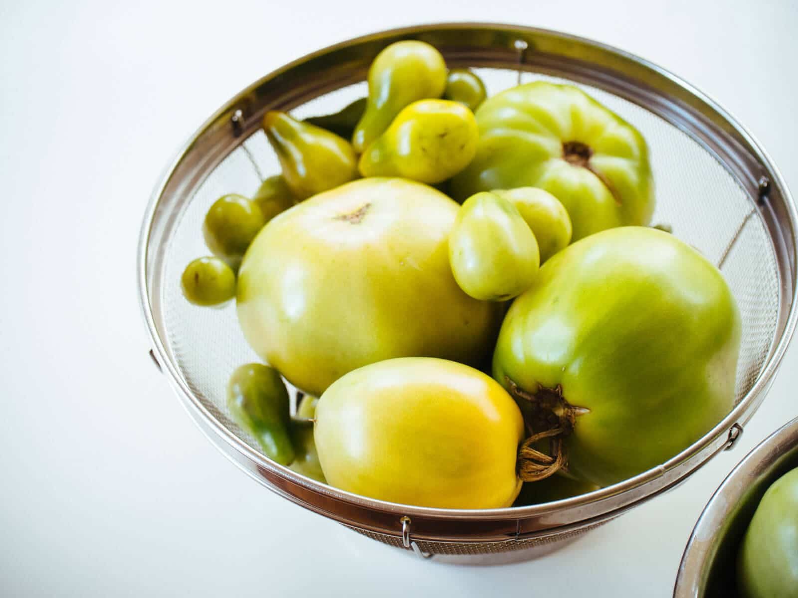 Funnel in tomatoes and pack jars tightly