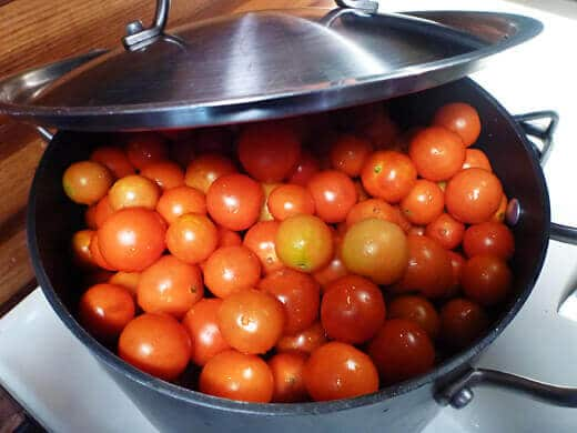 Dump cherry tomatoes into a big pot