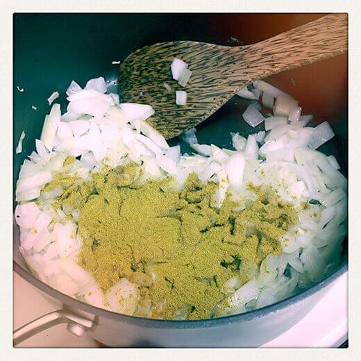 Stir curry powder into pot