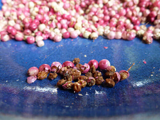 Brownish pink seeds from Peruvian pepper berry
