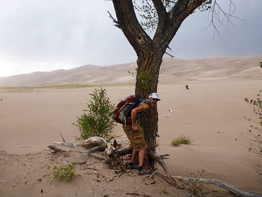 Taking cover during a Great Sand Dunes windstorm