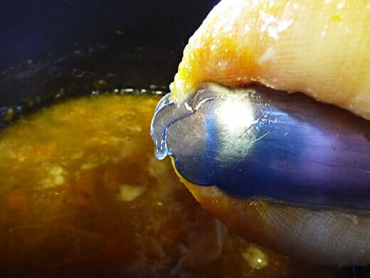 Use tongs to squeeze out natural pectin