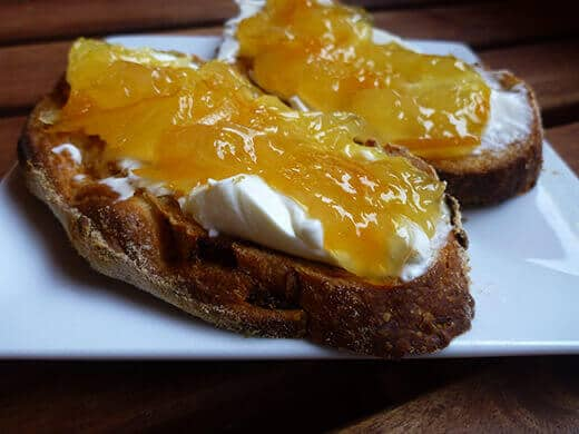 Orange-grapefruit-ginger marmalade with cream cheese on toast