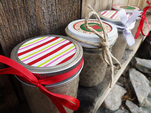 Jars of homemade chai concentrate prettied up with ribbon and paper
