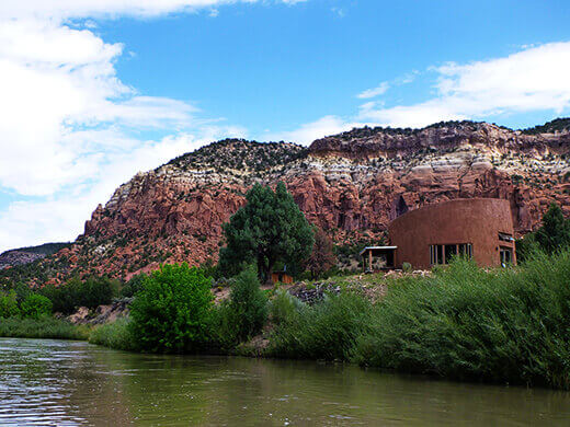 Adobe home on the Rio Chama riverbank