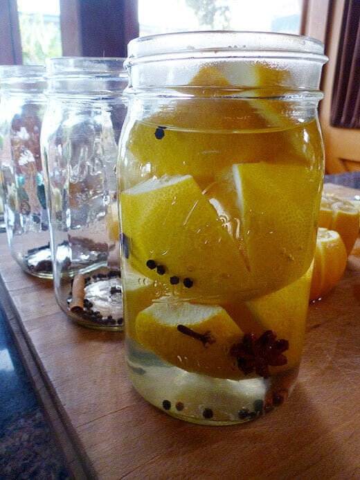 Pack lemons into a jar, then cover completely with brine