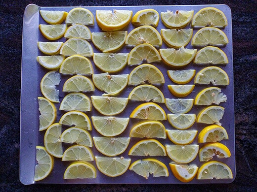 Lay lemon slices on a cookie sheet