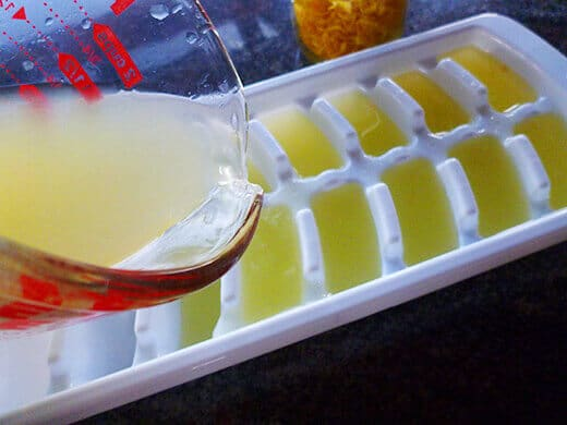 Lemon juice poured into an ice cube tray for freezing