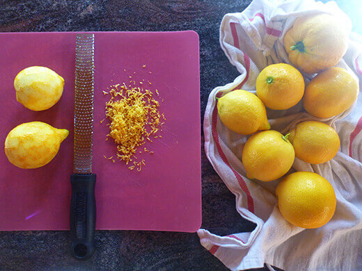 Wash, dry, and zest your lemons
