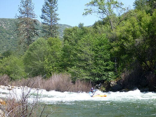 Powering through rapids on the Kings River