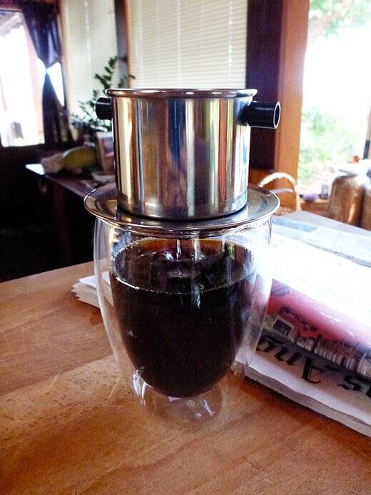 Single-cup slow drip of dark French roast coffee
