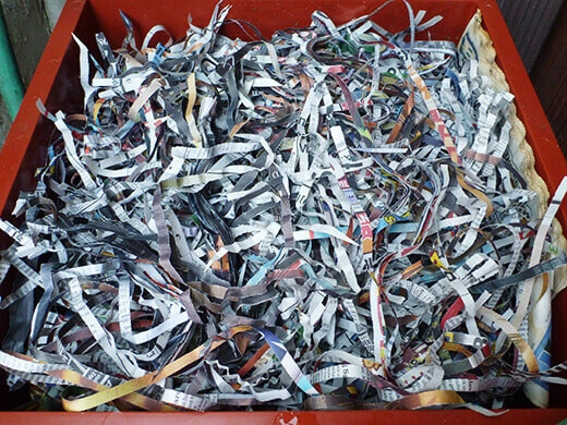 Add shredded paper to absorb excess moisture