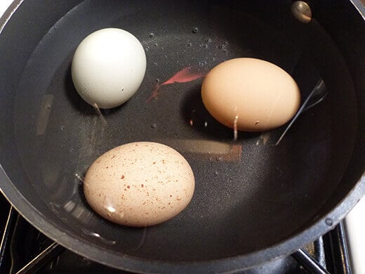 Cover eggs with cold water and bring to a rolling boil