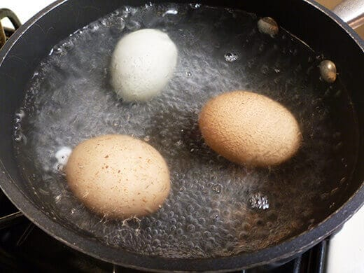 Lower heat and keep the eggs at a steady simmer for 10 minutes