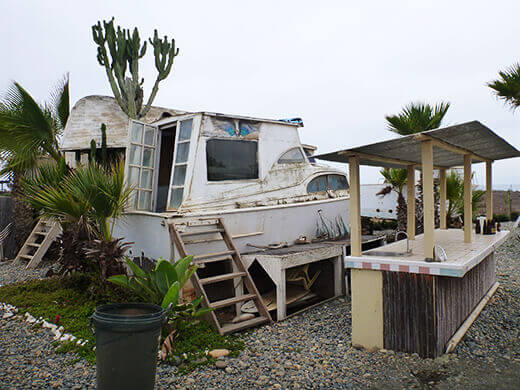 An old cabin cruiser turned surf shack