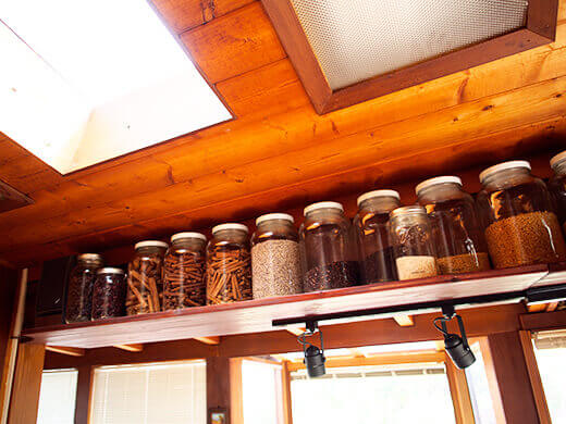 Open shelving filled with glass jars