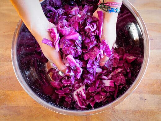 Massage the salt into the cabbage to draw out moisture