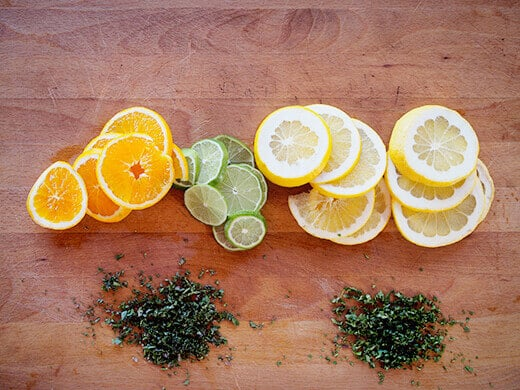 Sliced citrus and minced herbs