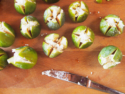 Fill each fig with goat cheese