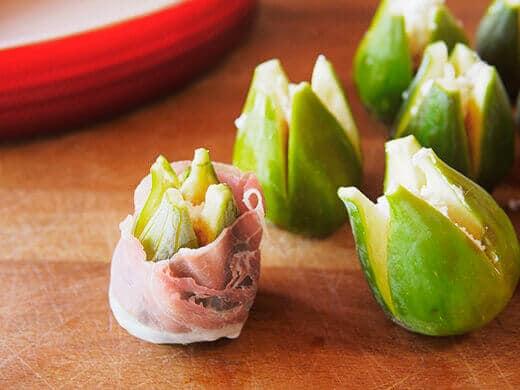 Wrap a strip of prosciutto around each fig