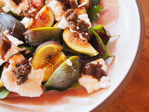 Spoon small heapings of fig jam onto burrata