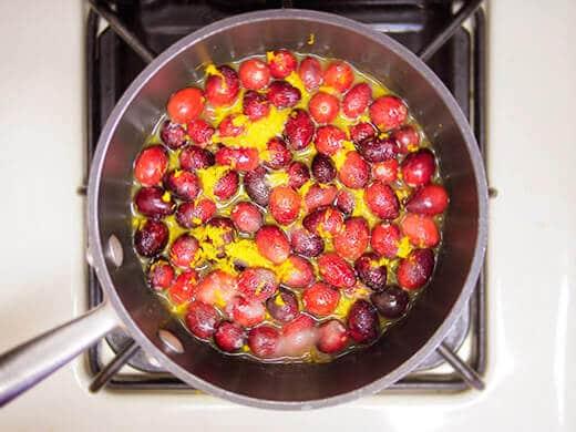 Heat cranberries until they start to burst