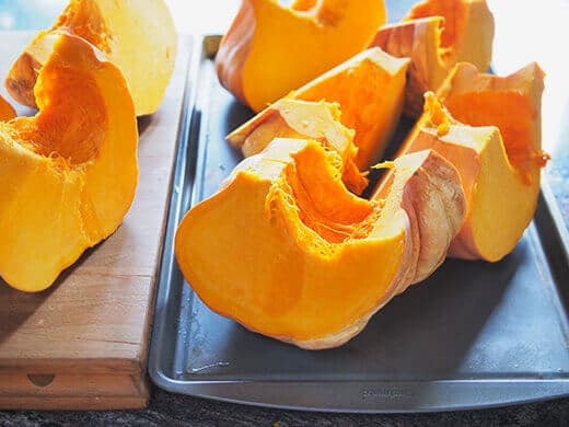 Arrange pumpkin wedges on baking sheet