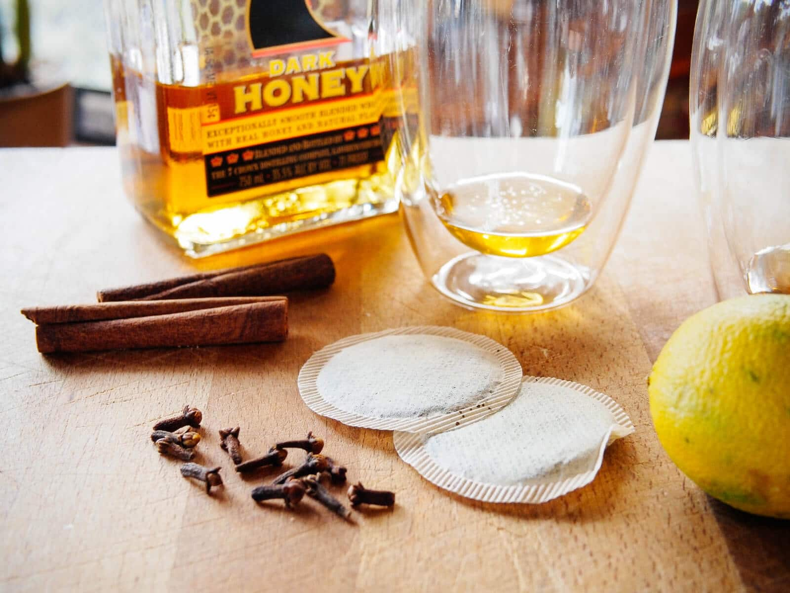 Float a clove-studded lemon in your hot toddy