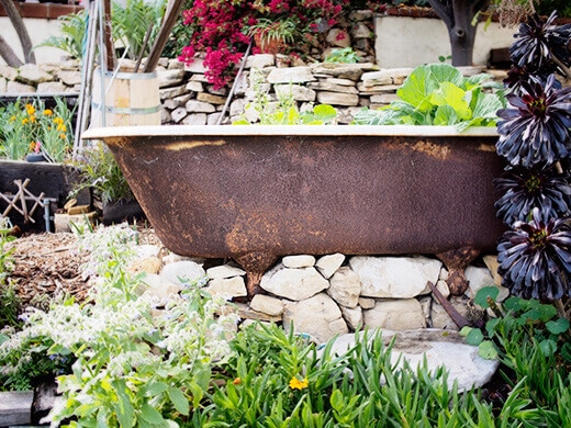 Clawfoot tub on stacks of stones