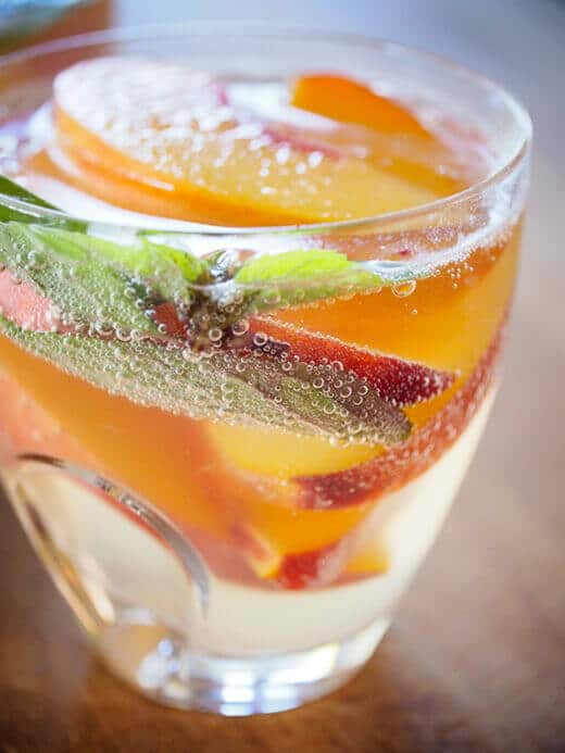 Moscato with fresh peaches, lemon and basil