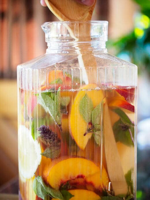 Combine all the sangria ingredients in a large pitcher