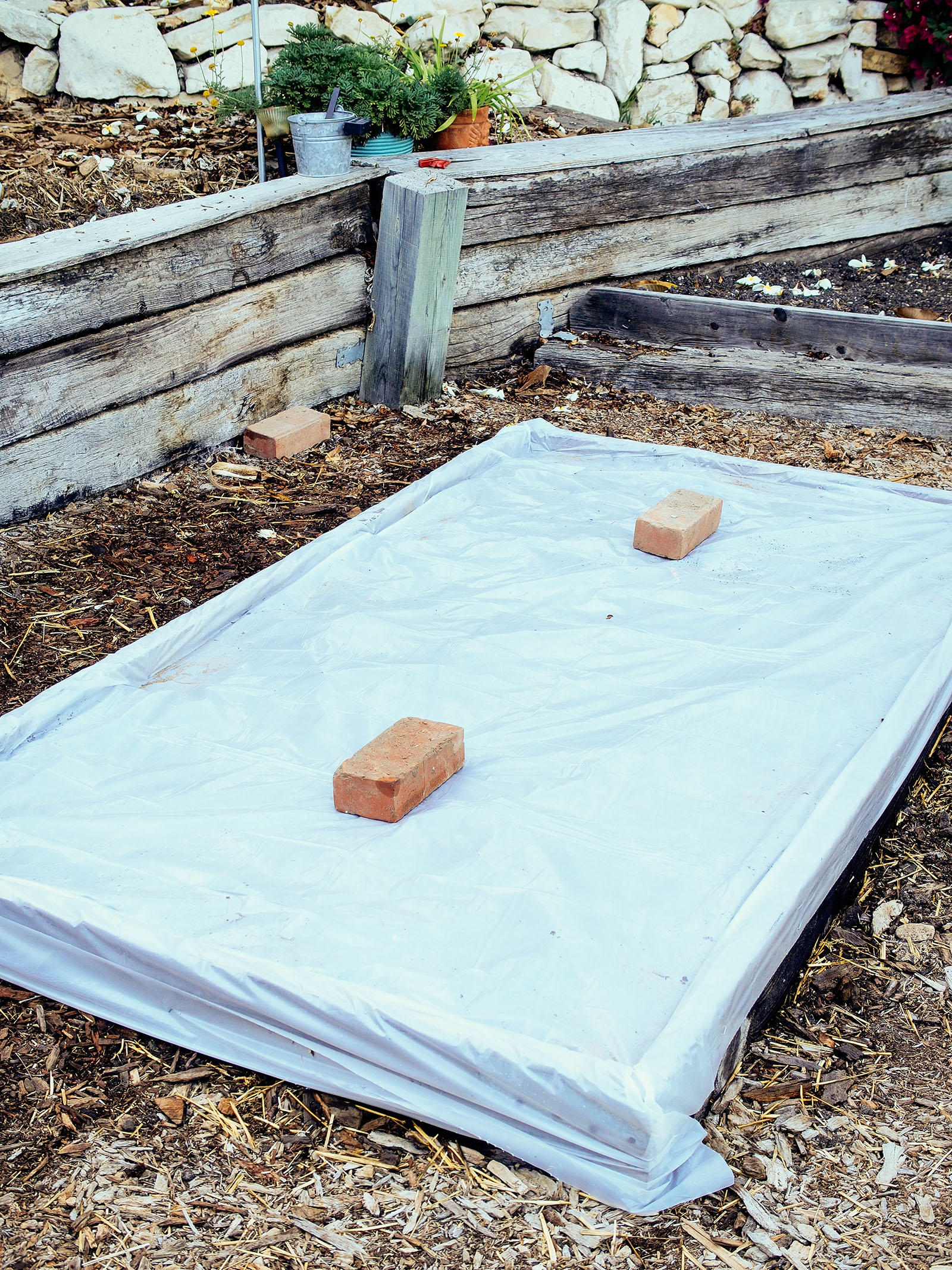 Raised bed wrapped in plastic