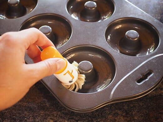 Brush oil into donut molds