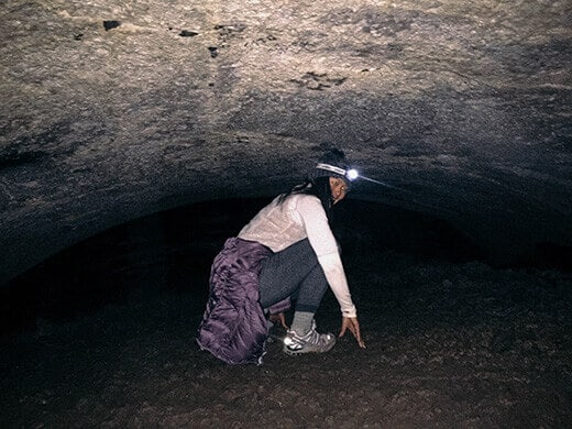 Crawling through the lowest section of the cave