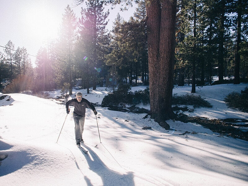 Cross-country skiing along a creek