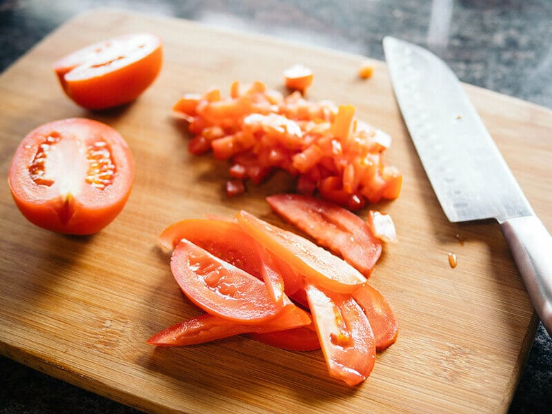 Finely chop tomatoes