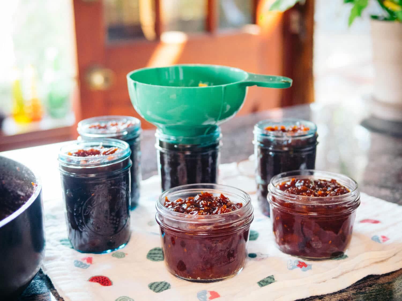 Ladle the jam into the prepared jars