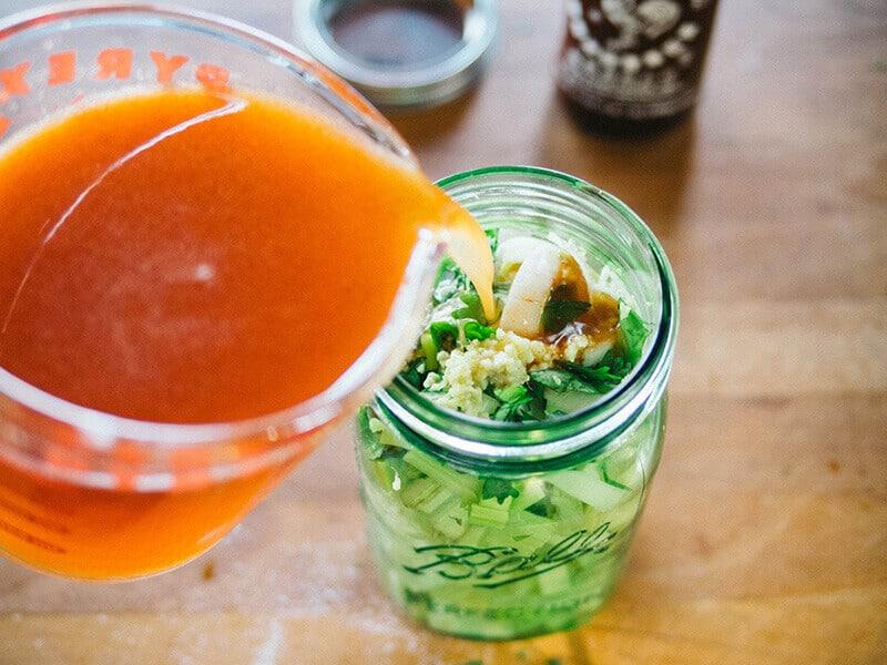 Pour in sriracha pickling brine