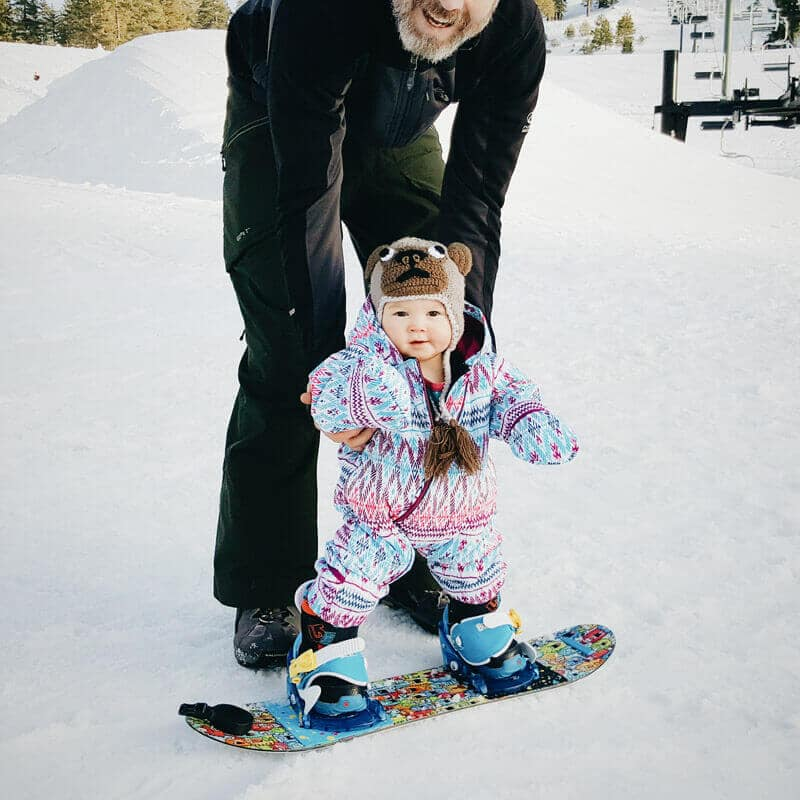 Introducing my 10-month-old baby to snowboarding