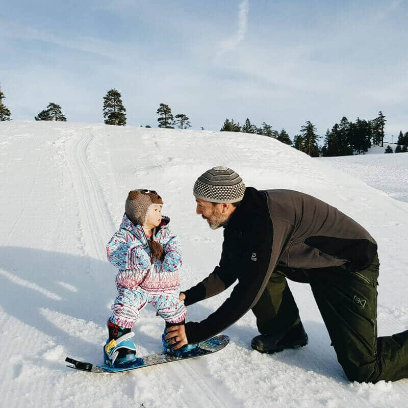 Teaching a toddler to snowboard