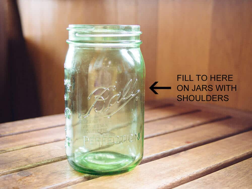 Fill quart jars to no more than 1 inch below the shoulders