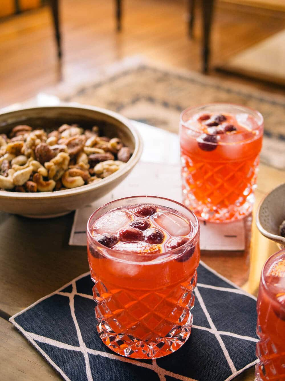 Cranberry moscow mules, sugared cranberries, and holiday nuts