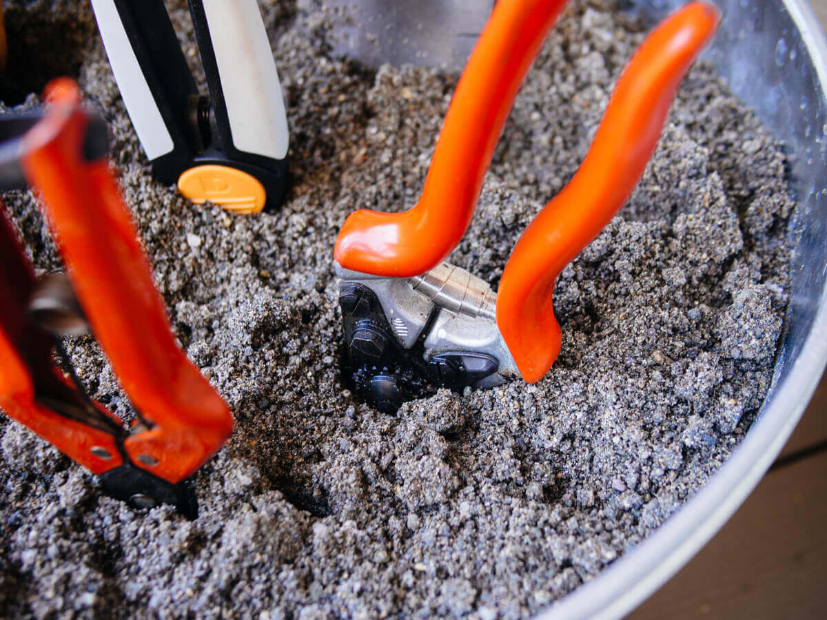 Gardening hand tools can easily be maintained in a bucket of sand mixed with oil