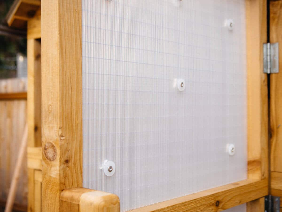 Twinwall plastic sheets provide weatherproofing on chicken coop