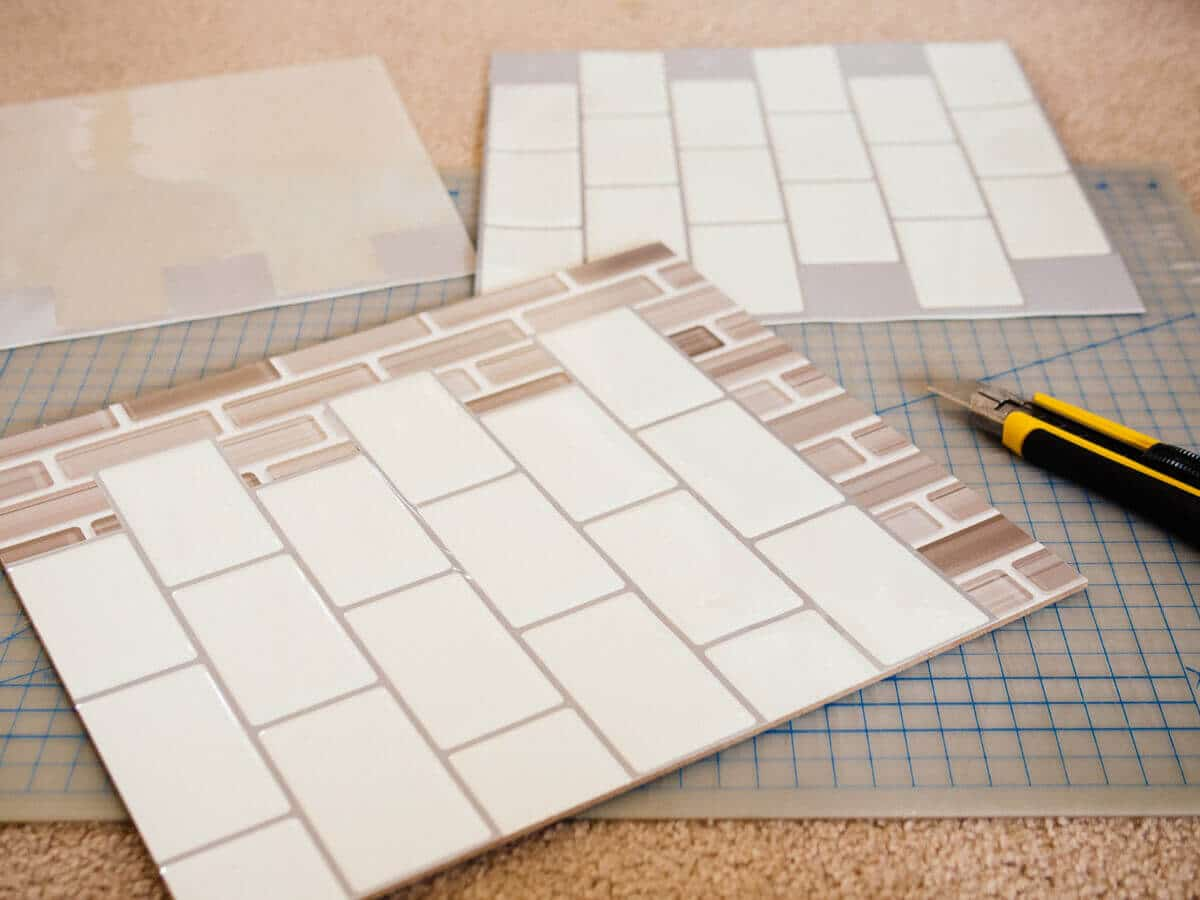 Covering the graphic backsplash panels with peel-and-stick tile