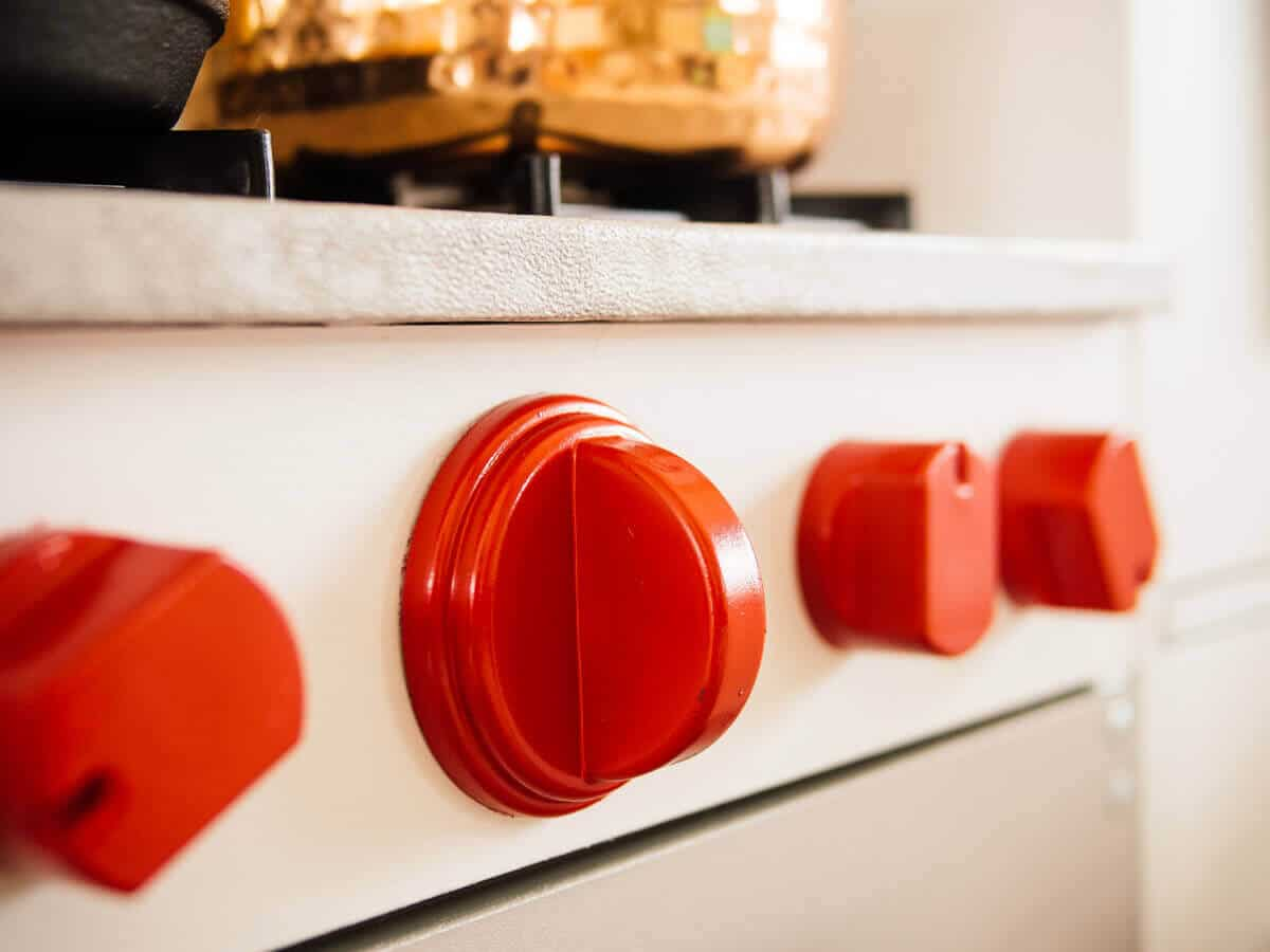Red knobs on a play kitchen stove range