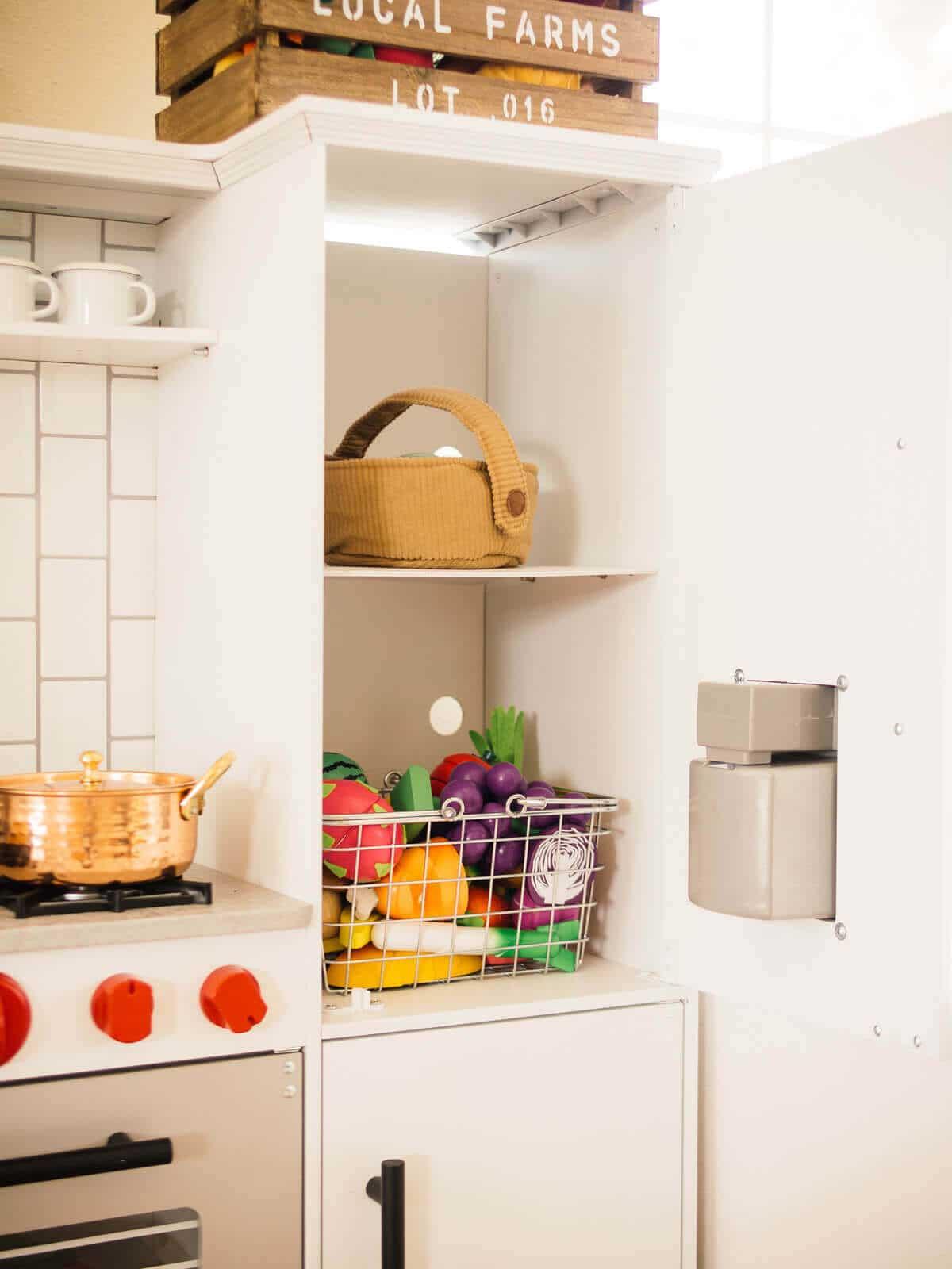 Shelf added to play fridge for extra storage
