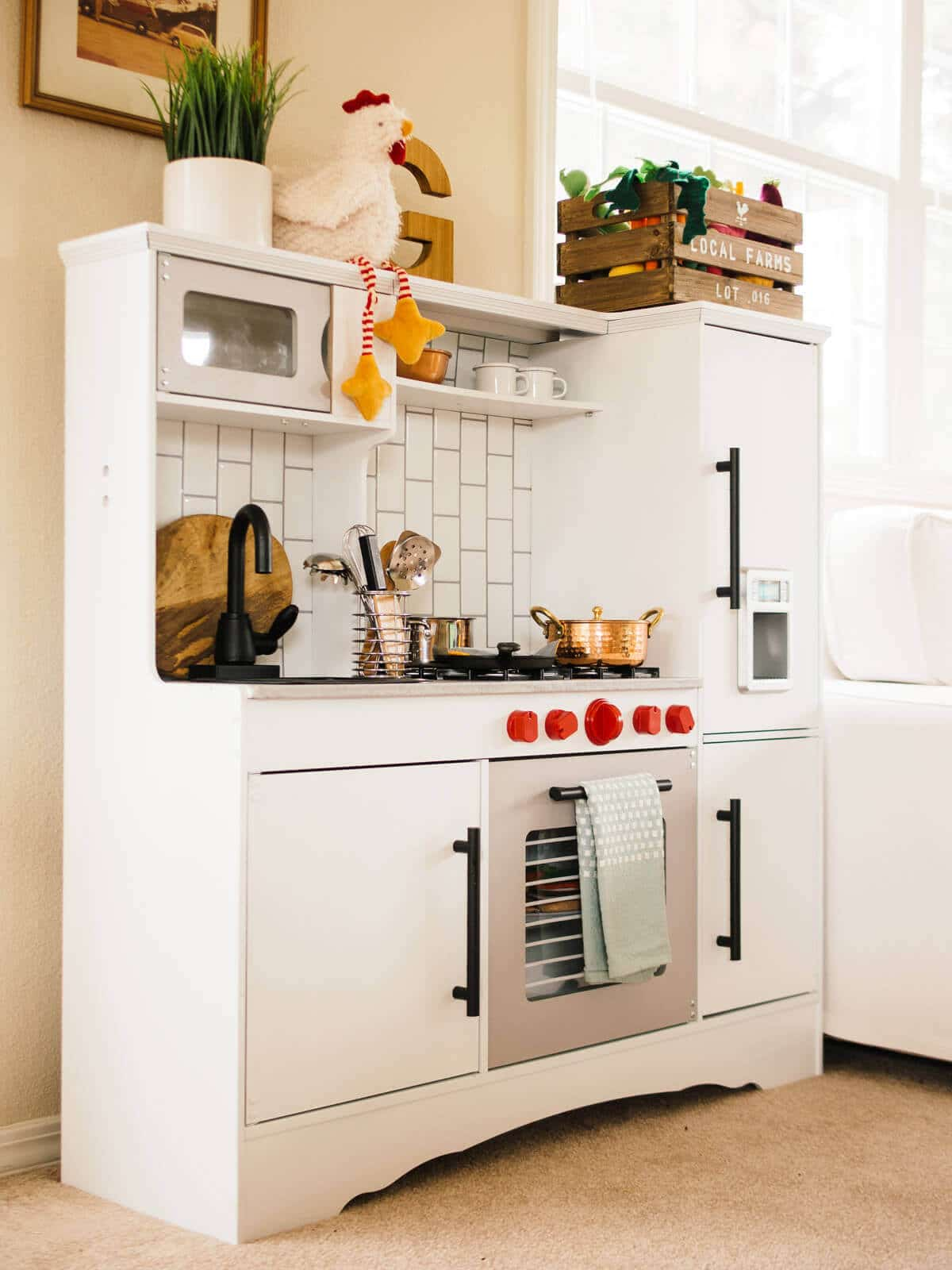 A warm and modern toddler play kitchen