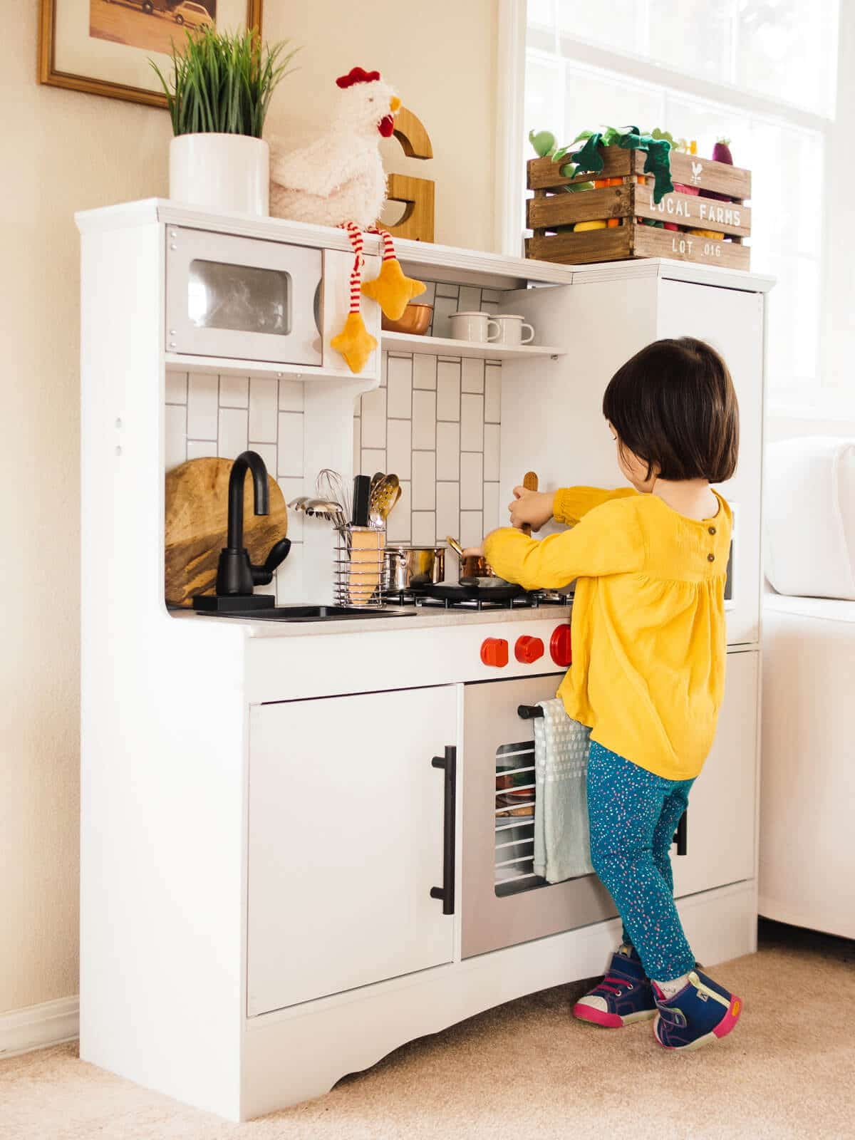 """Playing in her newly """"remodeled"""" toy kitchen"""