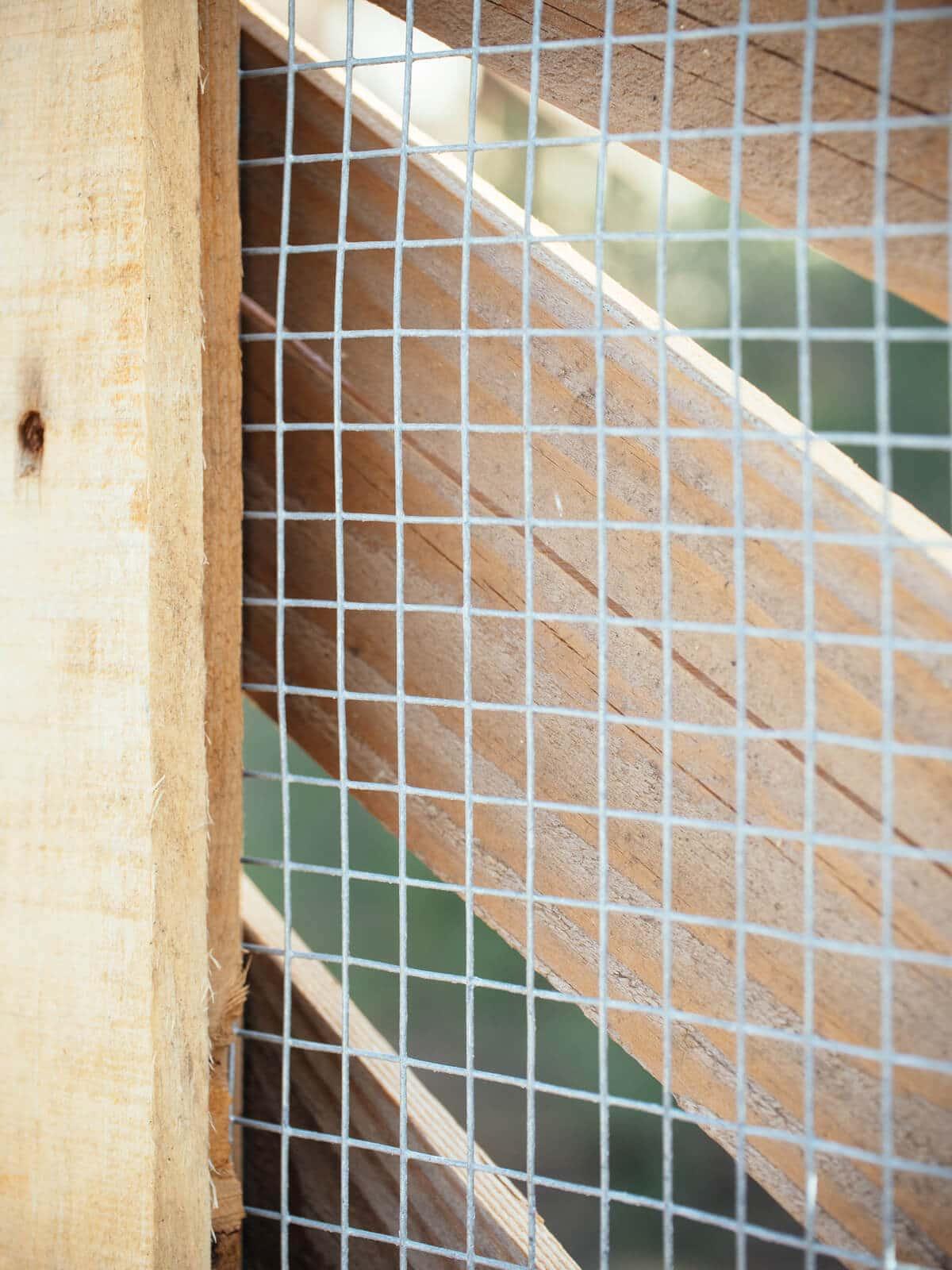 Heavy-gauge hardware cloth on chicken run fencing